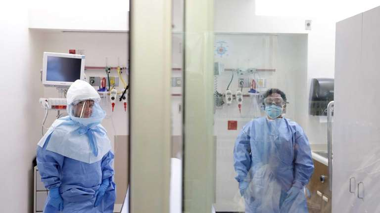 A medical worker wears a protective suit inside