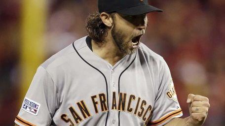 San Francisco Giants starting pitcher Madison Bumgarner reacts
