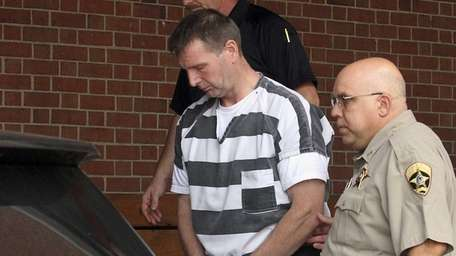 Curtis Lovelace, 45, is escorted out of the