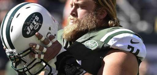 Jets center Nick Mangold (74) looks on before