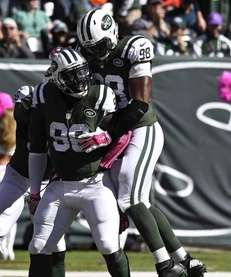 Jets defensive end Muhammad Wilkerson (96) celebrates a