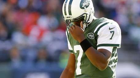 Geno Smith #7 of the Jets walks to