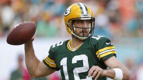 Green Bay Packers quarterback Aaron Rodgers throws a