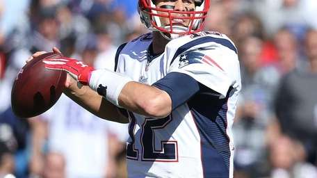 New England Patriots quarterback Tom Brady throws against