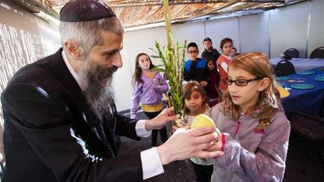 Rabbi Asher Vaisfiche gives a blessing to Jaclyn