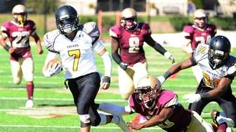 Evan Killen of St. Anthony's avoids a tackle