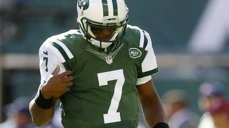 Geno Smith #7 of the Jets looks on