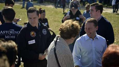 Republican gubernatorial candidate Rob Astorino meets with voters