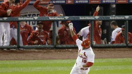 St. Louis Cardinals' Oscar Taveras celebrates as he