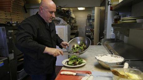Chef Michele Massimo prepares a salad on Oct.