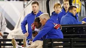 Victor Cruz #80 of the Giants is carted