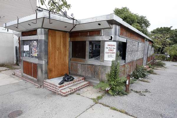 Abandoned and boarded up diner at 1527 Main