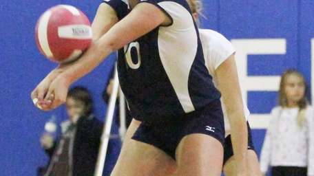 Bellport's Samantha Colombo (10) plays a serve against