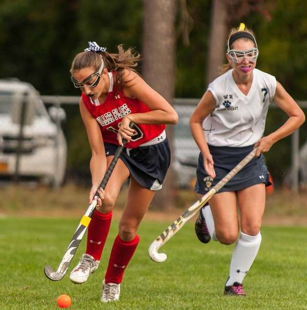 Miller Place's Ariana Esposito, left, brings the ball