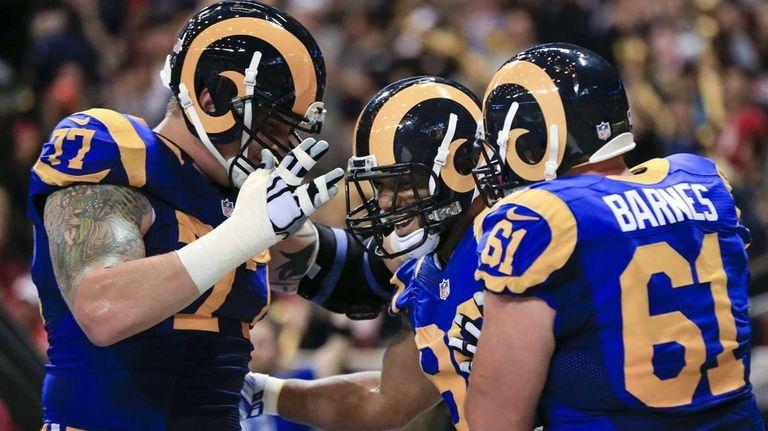 St. Louis Rams tight end Lance Kendricks, center,