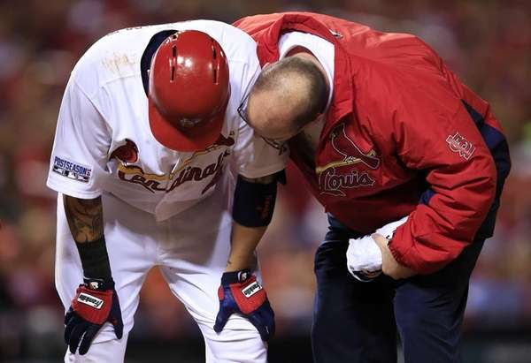 The St. Louis Cardinals' Yadier Molina #4 receives