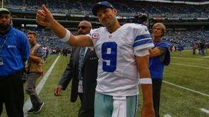 Dallas Cowboys quarterback Tony Romo leaves the field