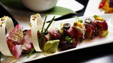 The Takayama sushi roll stars spicy tuna and