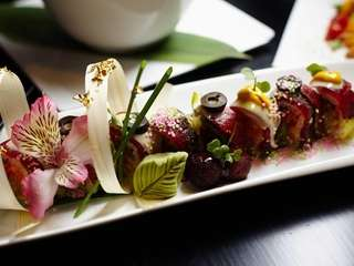 The Takayama sushi roll stars spicy tuna and