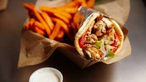 A delectable chicken gyro pita wrap is served