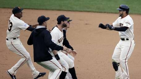 San Francisco Giants' Gregor Blanco, right, celebrates after