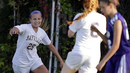 Sayville's Kelly Marra gets congratulations from Julianne Johnston