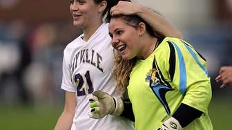 Sayville's Zoe Gomes embraces keeper Kiarra Grimes after