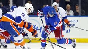 Derick Brassard of th Rangers attempts a second-period