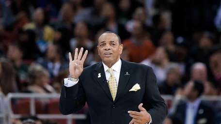 Head coach Lionel Hollins of the Nets reacts