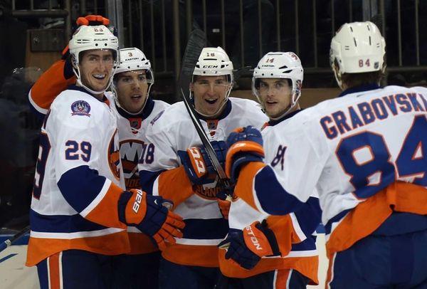 The Islanders celebrate a goal by Brock Nelson,
