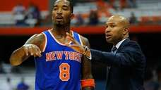 J.R. Smith #8 and head coach Derek Fisher