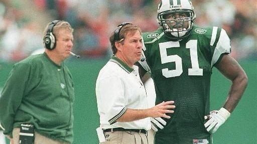 Jets defensive coordinator Bill Belichick, center, talks with