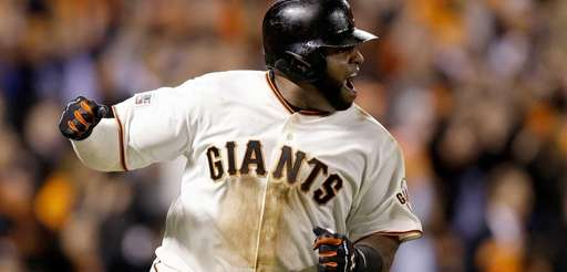 San Francisco Giants third baseman Pablo Sandoval reacts