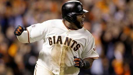 San Francisco Giants third baseman Pablo Sandoval reacts