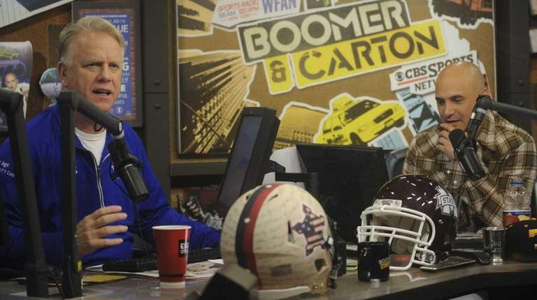 Boomer Esiason, left, and Craig Carton, right, host