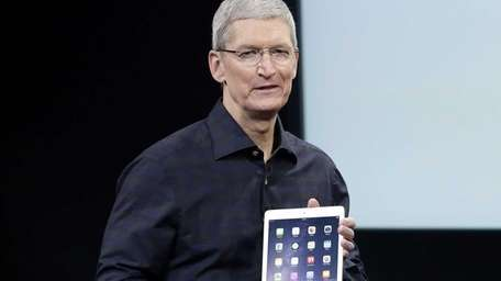 Apple CEO Tim Cook introduces the new Apple