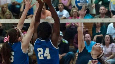 Bayport's Abby Auwearter (1, right), hits the ball