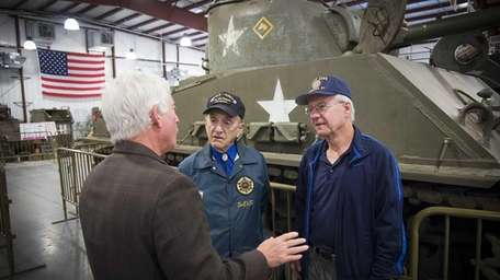 Assemblyman Charles Lavine, left, talks with World War