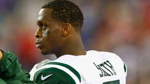 Jets quarterback Geno Smith looks on before a