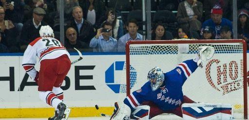 Rangers goalie Henrik Lundqvist (30) makes a save