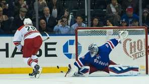 Rangers goalie Henrik Lundqvist (30) makes a save