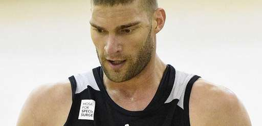 Nets center Brook Lopez looks on during the