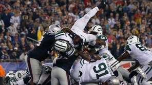 Chris Ivory #33 of the Jets scores a