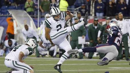 The Jets' Nick Folk (2) follows through on