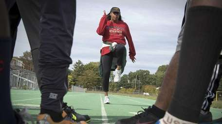 Patricia Taylor shows her team some moves at