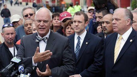 Atlantic City Mayor Don Guardian, left, speaks as