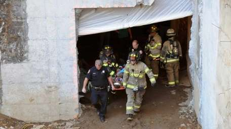 Responders conduct a search after a ceiling collapse