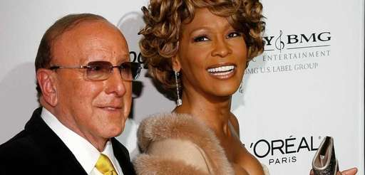 Music mogul Clive Davis and Whitney Houston arrive