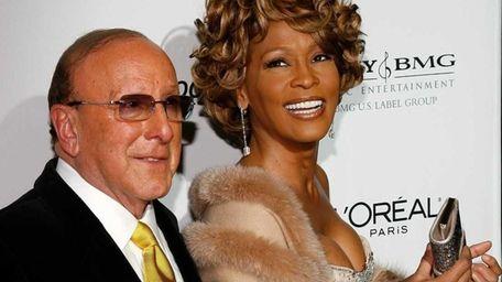 Music mogul Clive Davis and Whitney Houston arrive