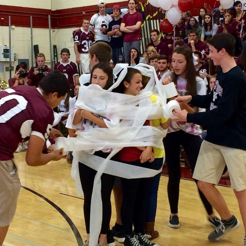 Juniors participate in the mummy wrap at the